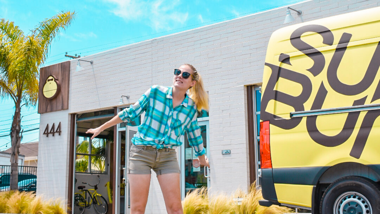 Having fun in front of the SunBum concept store in Encinitas on a sunny day. You can see the SunBum logo on the buidling on the left, and the SunBum truck is on the right of the picture.